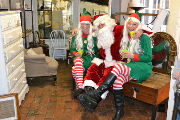 Santa and his little helpers visit forged & found and admire a new coffee table